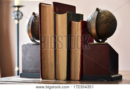Scenery of a book and the bookends on the table of the study
