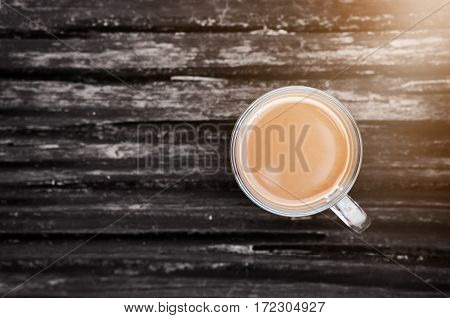 Top view of cup of hot coffee on log or timber background. copy sp