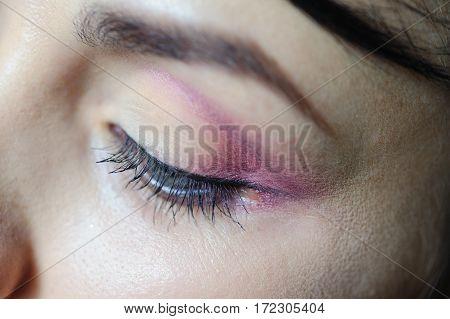 female eye with a light make-up closeup.
