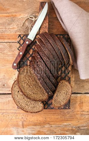 Freshly baked homemade artisan sourdough rye and white flour bread. Sliced. Top view. Close up. Copy space.