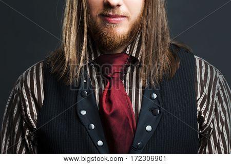 Handsome male Steam punk. Retro man portrait over grunge background.