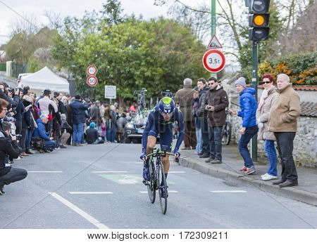 Conflans-Sainte-HonorineFrance-March 62016: The Spanish cyclist Jose Herrada Lopez of Movistar Team riding during the prologue stage of Paris-Nice 2016.