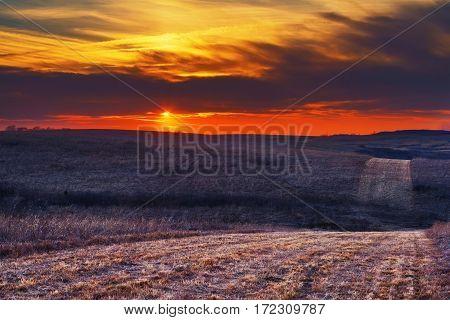 Wah-Kon-Tah Prairie at Sunset with a path going through the prairie