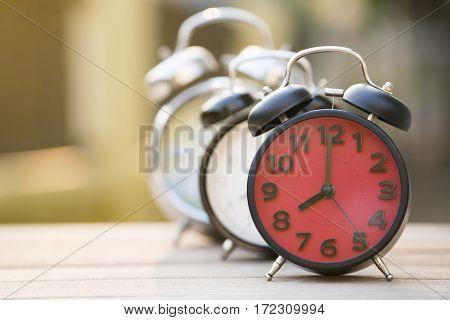 Retro alarm clocks on wooden table vintage style