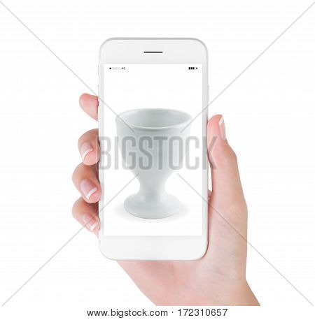 Woman using smart phone searching empty egg cup. Kitchenware concept isolated white background.