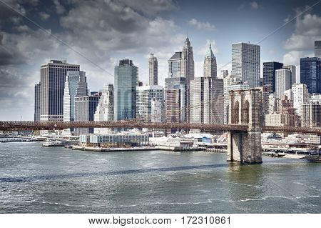 Lower Manhattan with Brooklyn Bridge at sunny day - HDR image.