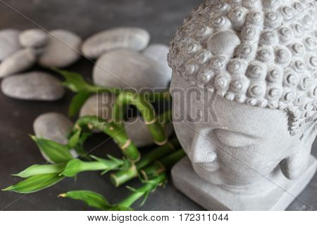 buddha head with stones , bamboo and tabular
