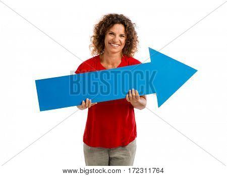 Happy mature woman holding a blue arrow