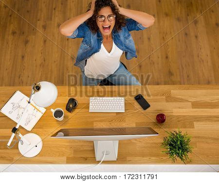 Top view of businesswoman in paning while working in an office