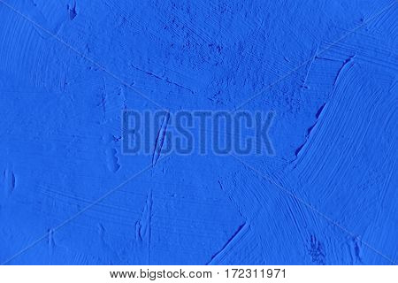 Painting close up of vivid blue color, paint brush strokes  texture for interesting, creative, imaginative backgrounds. For web and design.