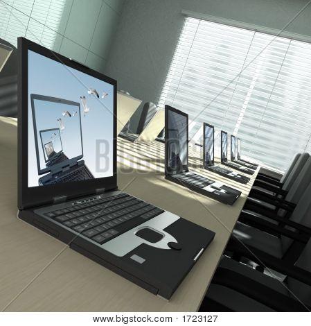 Laptops In An Empty Room