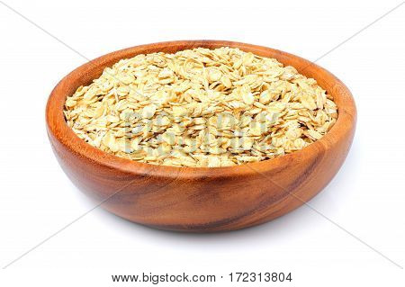Oat flakes in a wooden bowl isolated on white background.