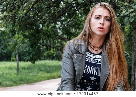 Young Beautiful Teenager Girl Standing On Background Of Openwork Lattice, Rock 'n' Roll. Rock Style.