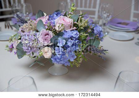 wedding flower arrangement with blue violet pink flowers