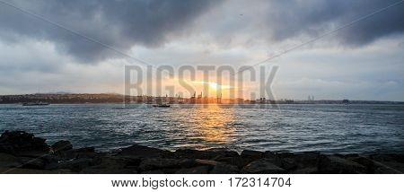 turkish fishermen during sunset in Istanbul Bosporus
