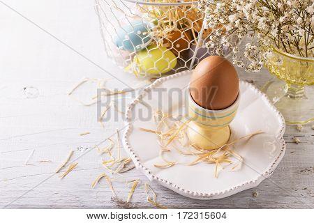 Egg In Egg Holder Over White Background