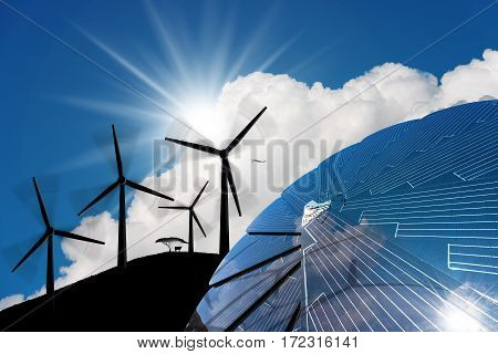 Detail of a solar panel in the shape of a flower with a 3D illustration of four silhouettes of wind turbines in mountain on a blue sky with clouds and sun rays