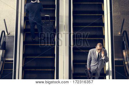 Business Men Escalator Talk Mobile