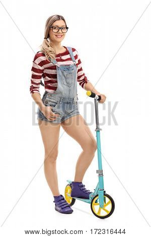 Full length portrait of a female hipster with a scooter isolated on white background