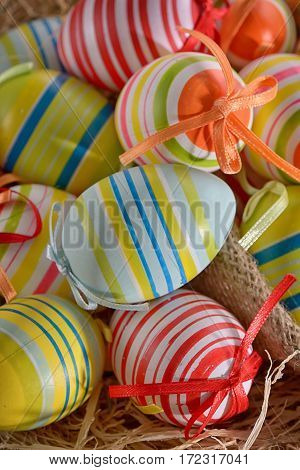 Colorful easter eggs isolated in basket, close up