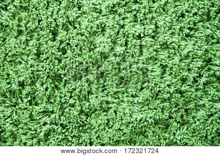 Light green wool carpet cloth texture for design and background. Floor and home decoration.