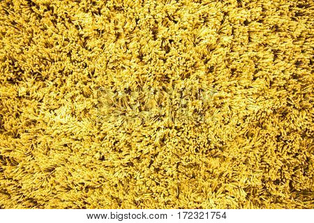 Light yellow wool carpet cloth texture for design and background. Floor and home decoration.
