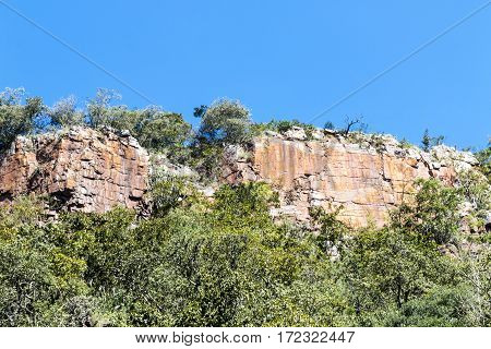 Surface Of Mountains Cliff Face Against Blue Sky