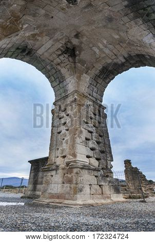 One of four pillars wich stand the Roman Arch of Caparra Caceres Spain