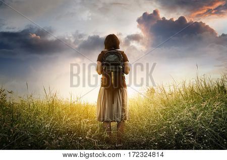Concept of challenge success victory struggle. Journey woman standing in nature with sunlight.