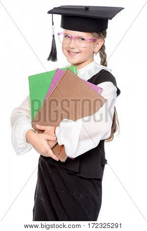Happy schoolgirl standing with books and smiling. Educational concept. Isolated over white.