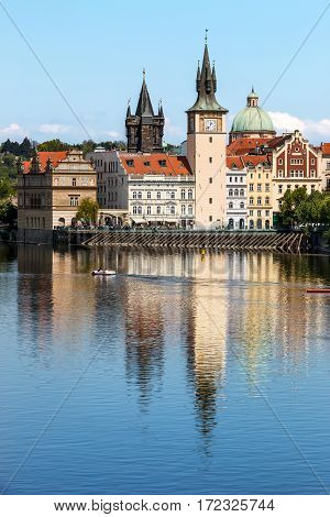 View Of The Church Clock In Prague With The Vltava River In Front