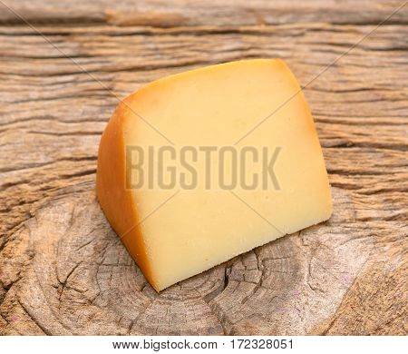 piece of cheese on wooden in studio