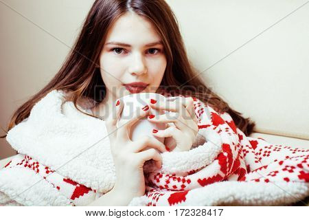 young pretty brunette girl in Christmas ornament blanket getting warm on cold winter, freshness beauty concept, lifestyle people close up
