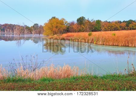 View of a fishing lake at Maple Leaf Conservation Area in Missouri during the autumn season