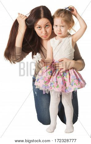 Mom and her daughter look straight ahead and them do not like their hairstyles, isolated on white background