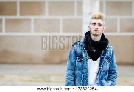 Man wearing bohemian chic clothing  posing on the street with copy space