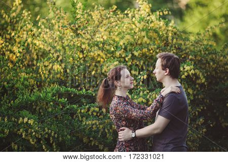Young happy loving couple having fun and enjoying in park