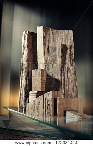 Architectural abstraction. Forms made of rough wood blocks and glass.