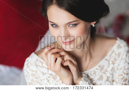 Face portrait of young beautiful woman bride in hotel sitting on bed