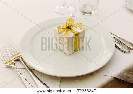 Wedding Bonbonniere with gold ribbon on plate