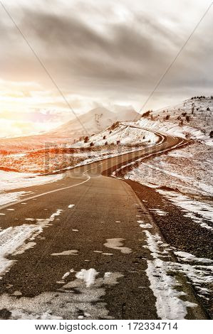 winter snow-covered road in the Caucasus mountains Elbrus mountain on background