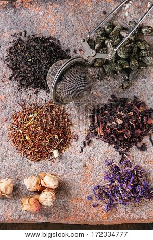 Variety Of Dry Tea With Teapot