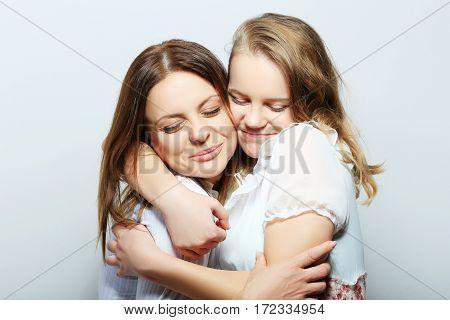 Mother and teen daughter portrait studio shot