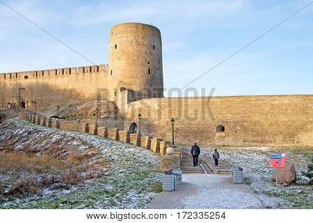 IVANGOROD, RUSSIA - JANUARY 3, 2017: People climb the stairs to The Ivangorod Fortress. The fortress was built in 1492 and named after Grand Prince of Russia Ivan III. Now it is a museum