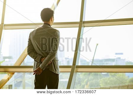 Young business man look out window - Business idea concept