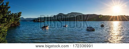 The Lac de Serre Poncon with small boats in the Bay of Saint Michel.