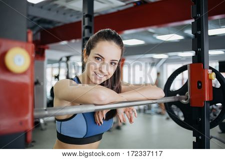 Young Woman At The Gym Using Fitness Equipment.