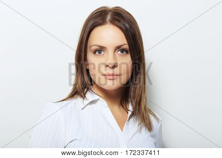 Beautiful confident woman with serious expression studio shot