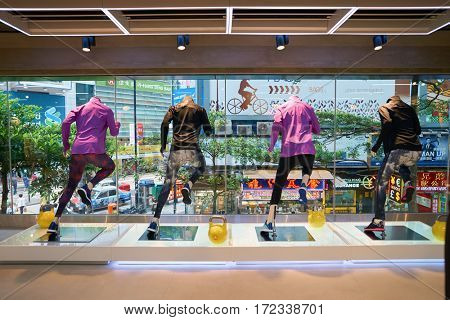 HONG KONG - CIRCA NOVEMBER, 2016: inside Adidas store in Hong Kong. Adidas AG is a German multinational corporation that designs and manufactures shoes, clothing and accessories.