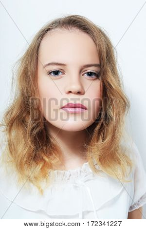 Young Teenage Girl Face Looking Rebellious close up